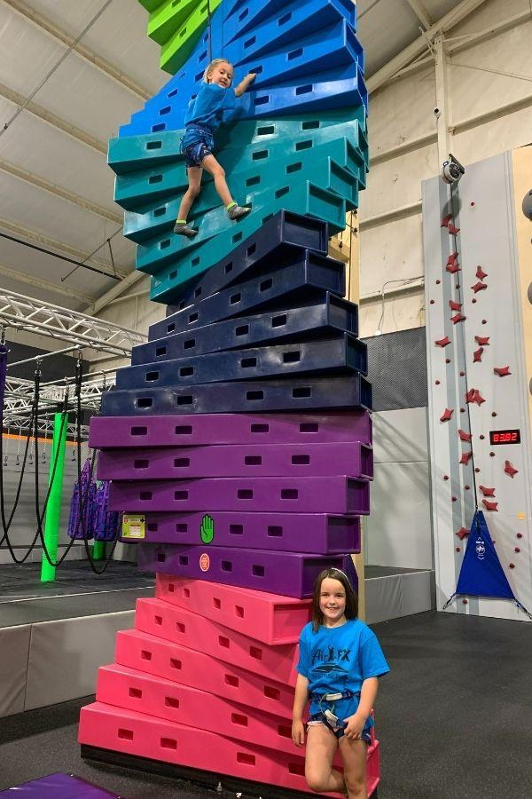 Camp girl climbing on Twister
